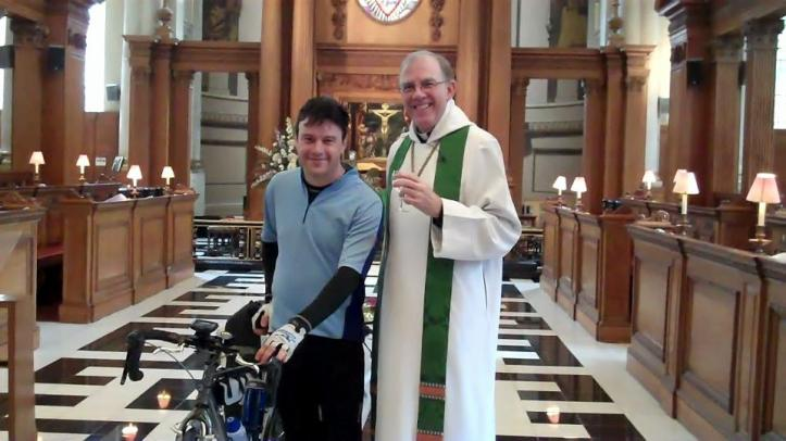 Paddy, pictured with Herman the bicycle, blessed by with the Ven. the Archdeacon of London at St Brides Church, Fleet Street. Photo: © Charles Christie-Webb