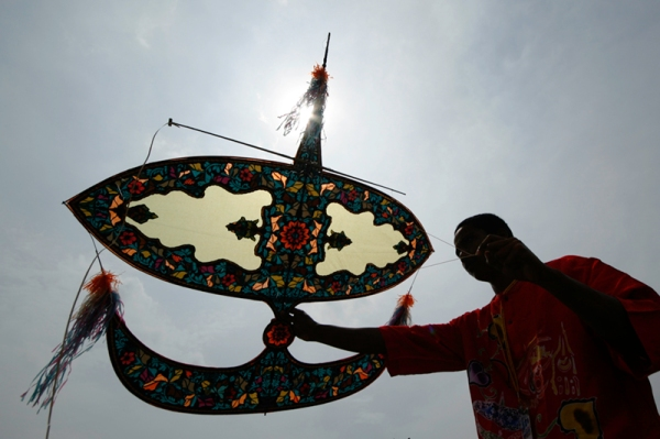 A man and his kite at the International Kite Festival in Pasir Gudang, Johor, Malaysia. Photo: ©Tourismjohor.com